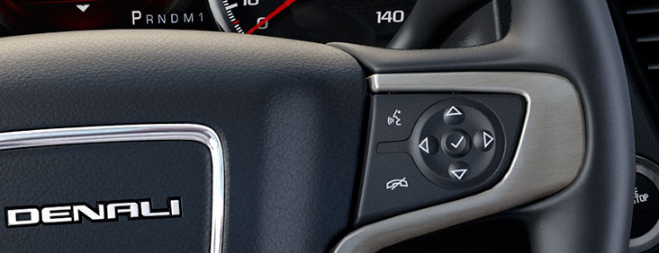 Steering wheel controls of the 2015 Yukon Denali XL full size extended luxury SUV.